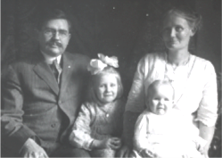 black and white photo of family with mother and father and two children